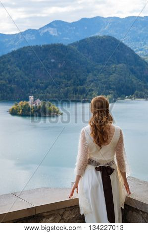 Bride in a castle looking at Lake Bled, Slovenia