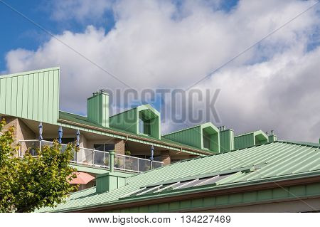 a Green Metal Roof on Apartment building