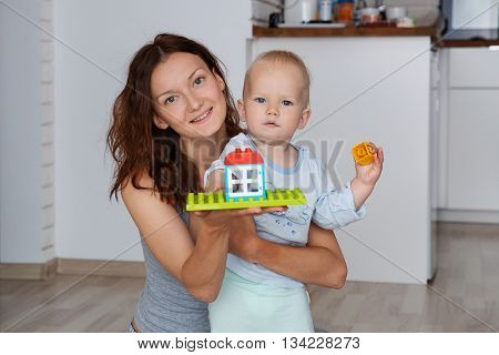 Mother and child playing and discovery at a home interior