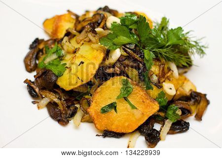 Potato with ceps and herbs on white