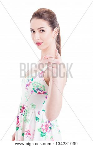 Pretty Woman Standing And Pointing At Camera With One Hand