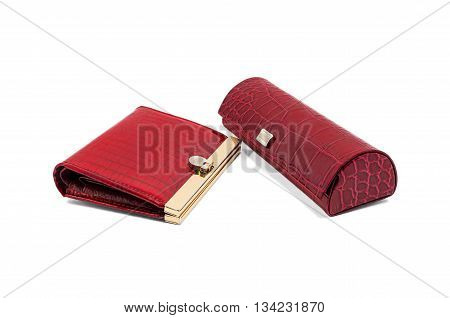 Red wallet and glasses case made of crocodile leather on a white background