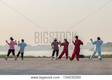 Vientiane Laos - Oct. 312015: People exercise Tai Chi in morning at edge Mekong RiverOct 31 Vientiane Laos
