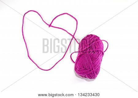 Big heart made of purple skein of thread isolated