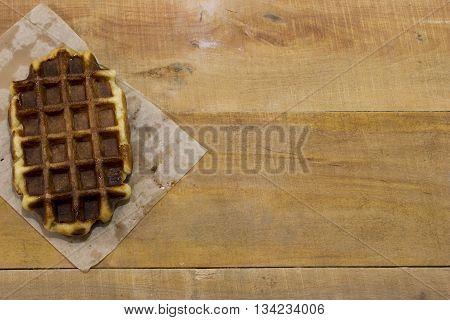 Fresh belgian waffles lying on the desk.