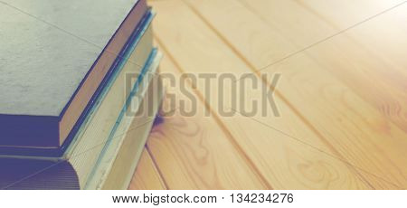closeup cover book on brown wooden table for background the blank space for text