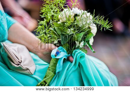 Wedding Bouquet On Hand Of Bridesmaid On Turquoise Dress