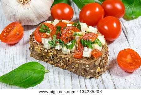 Ciabatta Bread With Tomatoes, Mozzarella And Basil.