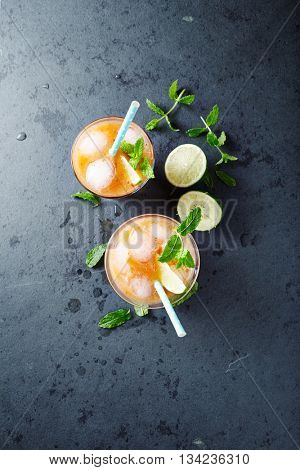 Peach Aqua Fresca with Lime Juice and Mint Leaves