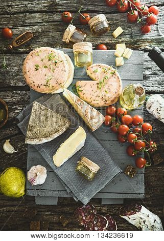 Cheese and Salami. Variety od cold cuts. Cheese on wood. Types of cheese and sausages