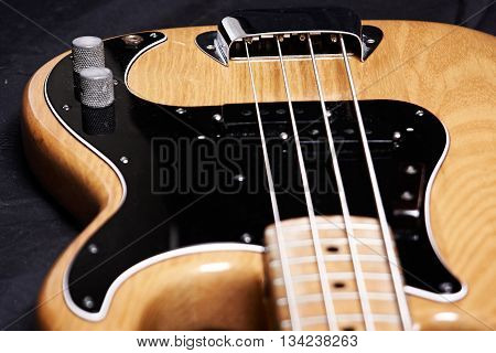 Electric bass guitar closeup focus back on strings