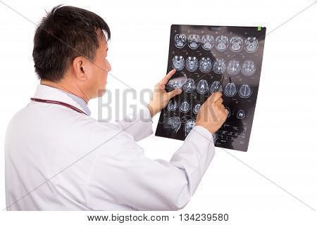 Matured Asian Neurology Medical Doctor Examining Head Mri Images