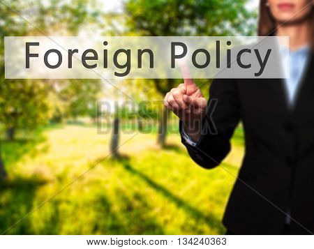 Foreign Policy - Businesswoman Hand Pressing Button On Touch Screen Interface.