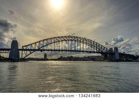 SYDNEY, AUSTRALIA - APRIL 18: View on famous Harbour bridge in Sydney downtown. Bridge is on of most reconizable city's landmarks. April 2016