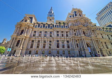 Philadelphia, USA - May 5, 2015: Philadelphia City Hall with the fountain on Penn Square. Tourists on the square. Pennsylvania USA.