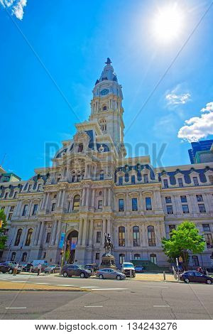 Philadelphia, USA - May 5, 2015: Philadelphia City Hall with William Penn monument on the Tower. View from the street. Tourists in the street