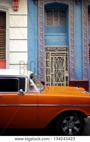 classic old orange car in havana, cuba