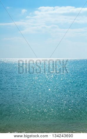 Beautiful seascape. Calm sea. Endless Ocean. Calm sea vertical background. Sunny day at sea. Sky and sea.