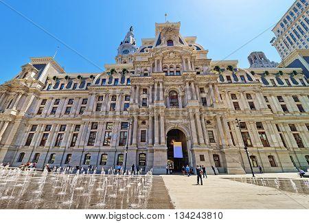 Philadelphia, USA - May 5, 2015: Philadelphia City Hall with a fountain on Penn Square. Tourists on the square. Pennsylvania USA.