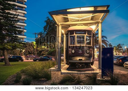 Adelaide Australia - November 8 2014: Historic red rattler tram in Glenelg on a permanent display at night time. Color-toning and long exposure effect.