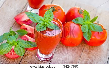 Healthy drink, refreshing drink - tomato smoothie (tomato juice) on wooden table