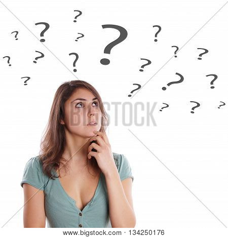 pensive young woman looking up at question marks