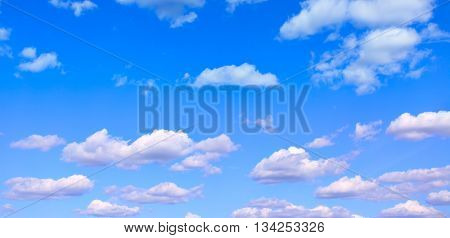Blue sky with light cumulus clouds - panoramic view