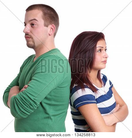 young couple sulking after an argument, isolated on white