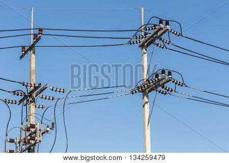 Electric Pole Connect High Voltage Electric Wires On Blue Sky