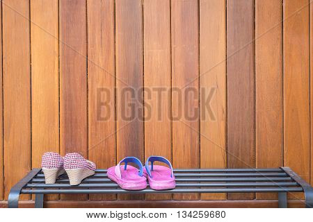 Shoes On Black Metal Shoes Shelf On Wooden Background