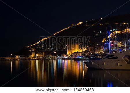 ALANYA, TURKEY - NOVEMBER, 13: Night view of harbour, port red tower and fortress in Alanya, Antalya province, Turkey, taken in Autumn, 2015.