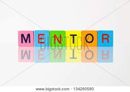 Mentor - an inscription from children's wooden blocks