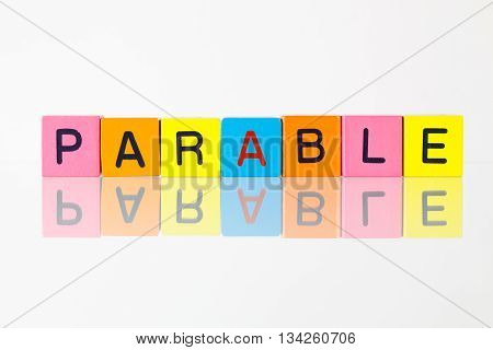 Parable - an inscription from children's wooden blocks