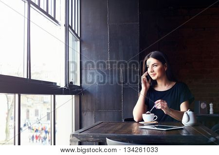 Young Cute Girl Talking On The Phone In Cafe.
