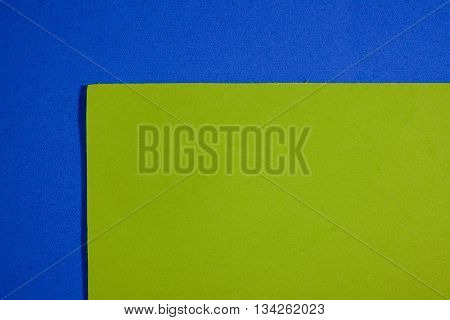 Eva foam ethylene vinyl acetate smooth apple green surface on blue sponge plush background
