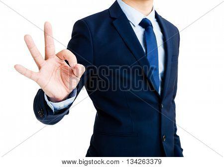 Businessman showing ok sign gesture