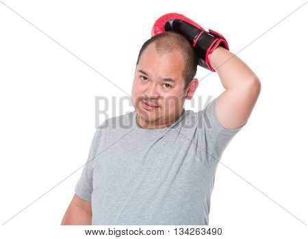 Asian man wearing boxing gloves and put on his head