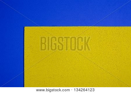 Eva foam ethylene vinyl acetate sponge plush lemon yellow surface on blue smooth background