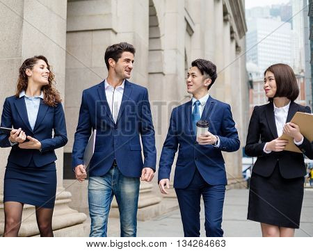 Group of business people walking outside