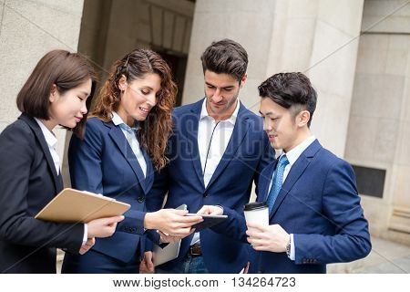 Group of business people use of digital tablet