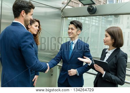 Group of business people hand shaking