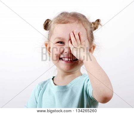 Kid Testing Vision. little girl closed one eye hand eye test