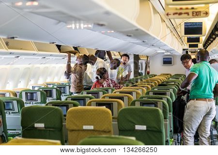 ADDIS ABABA, ETHIOPIA - circa FEBRUARY 2016: Inside of Ethiopian Airlines aircraft with passengers boarding in