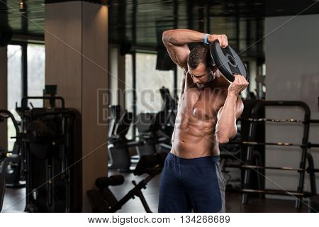 Young Man Workout Abs With Weights