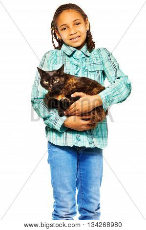 Little African girl standing holding small cat with love and care isolated on white