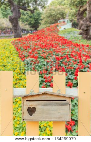 postbox wooden fence background a flower garden.