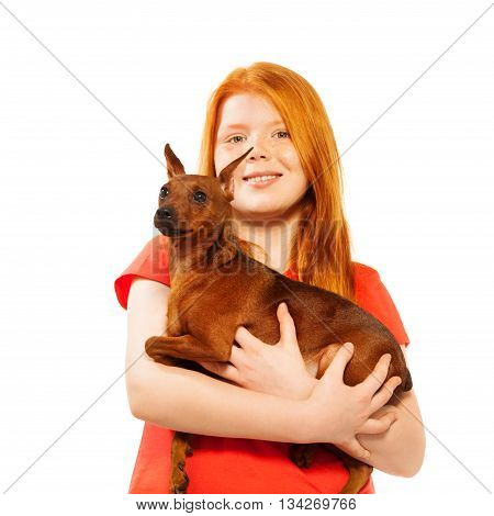 Beautiful red girl hold red miniature pinscher dog isolated on white portrait