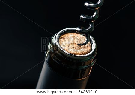 Cork bottle wine with corkscrew close up