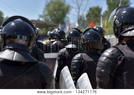 Fighters of the special police units armed with special facilities for mass action