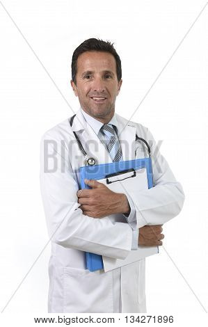 corporate portrait of confident 40s attractive male medicine doctor with stethoscope on shoulders and medical gown standing proud and happy holding clipboard isolated on white background